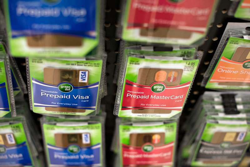 Prepaid MasterCard Inc. and Visa Inc. gift cards are displayed for sale at a Kroger Co. store in Peoria, Illinois, on Tuesday, June 16, 2015.