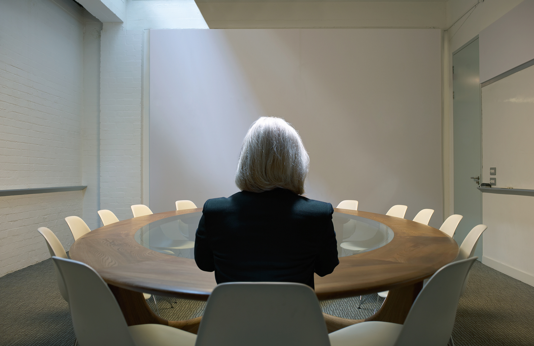Female at board table