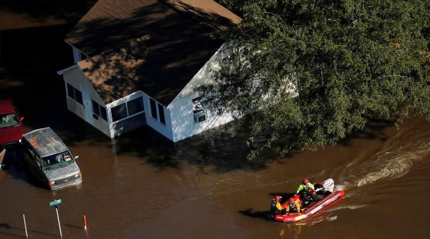 A swift water rescue team is seen making its way through a flooded area after Hurricane Matthew in Lumberton, North Carolina October 10, 2016.