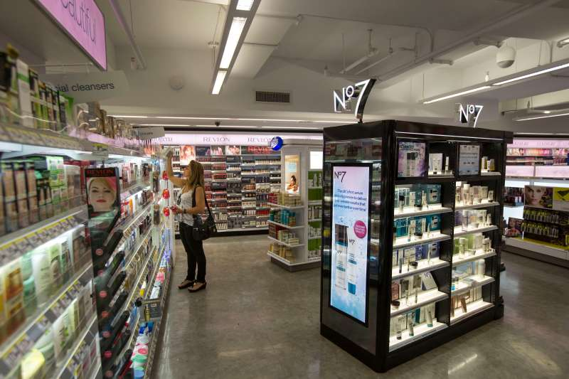 A woman browses products at a Walgreens store in New York. Women typically pay 7% more than men for similar products.