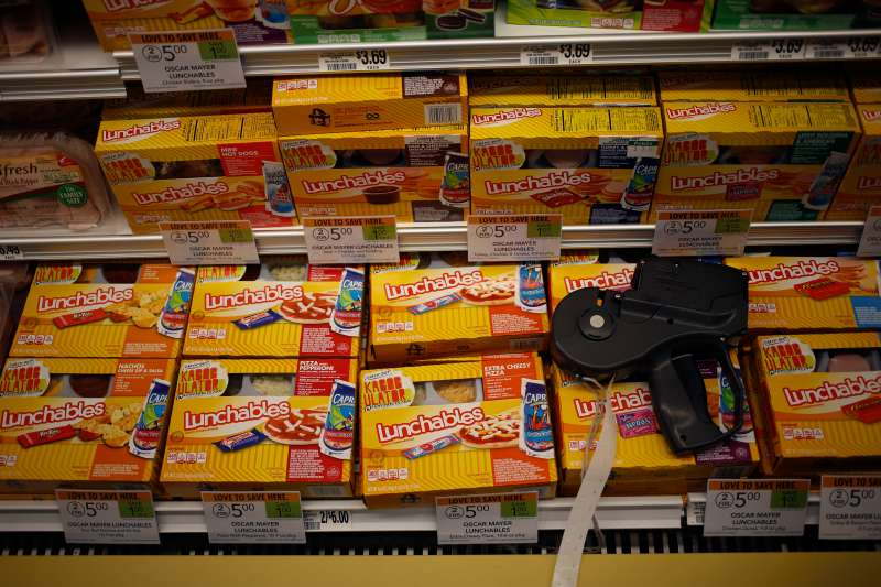 A price gun sits on top of packages of Oscar Mayer Co. Lunchables at a Publix Super Markets Inc. grocery store in Knoxville, Tennessee, U.S., on Wednesday, March 5, 2014. Publix's sales for the fourth quarter of 2013, were $7.4billion, a 5.3 percent increase from last year's $7.0 billion. Photographer: Luke Sharrett/Bloomberg via Getty Images