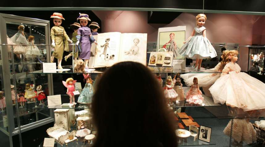 Visitors view historic handmade dolls on display at The Alexander Doll Company in New York City. Howard Kahn, leader of Kahn Lucas, owns the Madame Alexander Doll brand.