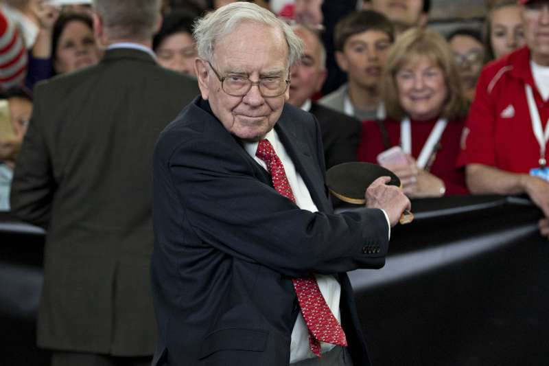 Warren Buffett, chairman and chief executive officer of Berkshire Hathaway Inc., plays table tennis.