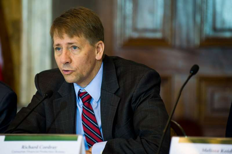 Director of the Consumer Financial Protection Bureau, Richard Cordray, delivers remarks during a public meeting of the Financial Literacy and Education Commission at the United States Treasury on June 29, 2016 in Washington, DC.