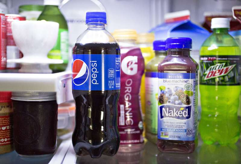 Bottles of PepsiCo Inc: Pepsi, Gatorade G Organic, Naked juice smoothie, and Mountain Dew brand beverages