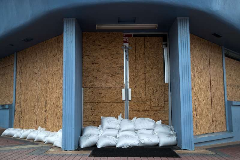 A storefront is barricaded with sandbags in Daytona Beach, Florida.