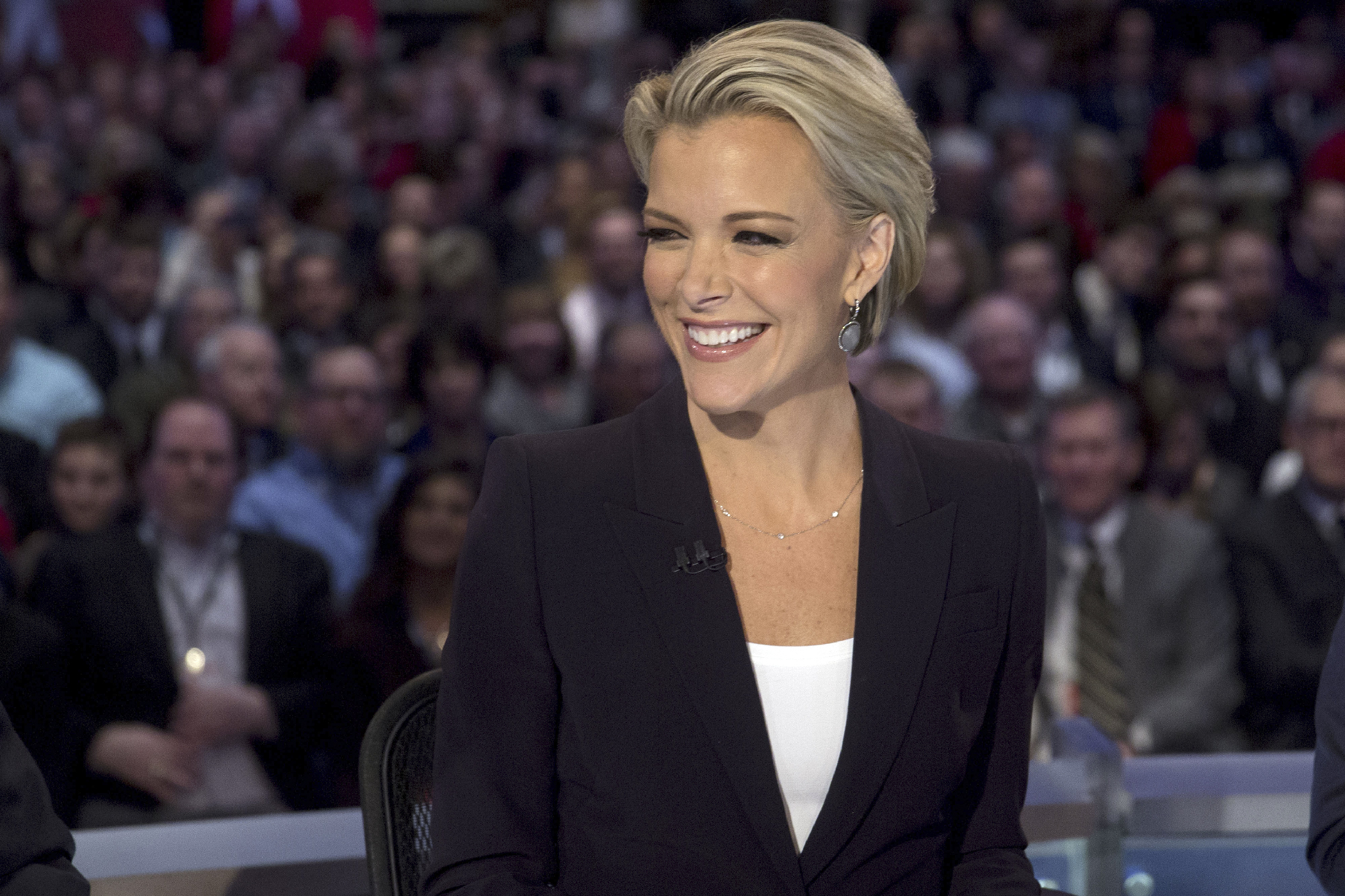 Fox News anchor Megyn Kelly smiles as she waits to begin the Republican presidential candidate debate at the Iowa Events Center in Des Moines, Iowa, U.S., on Thursday, Jan. 28, 2016. Candidates from both parties are crisscrossing Iowa, an agricultural state of about 3 million people in the U.S. heartland that will hold the first votes of the 2016 election on Feb. 1.