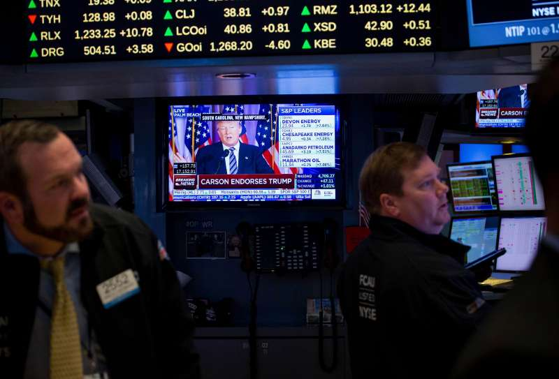 Donald Trump, president and chief executive of Trump Organization Inc. and 2016 Republican presidential candidate, is seen speaking on a monitor as traders work on the floor of the New York Stock Exchange (NYSE) in New York, U.S., on Friday, March 11, 2016.