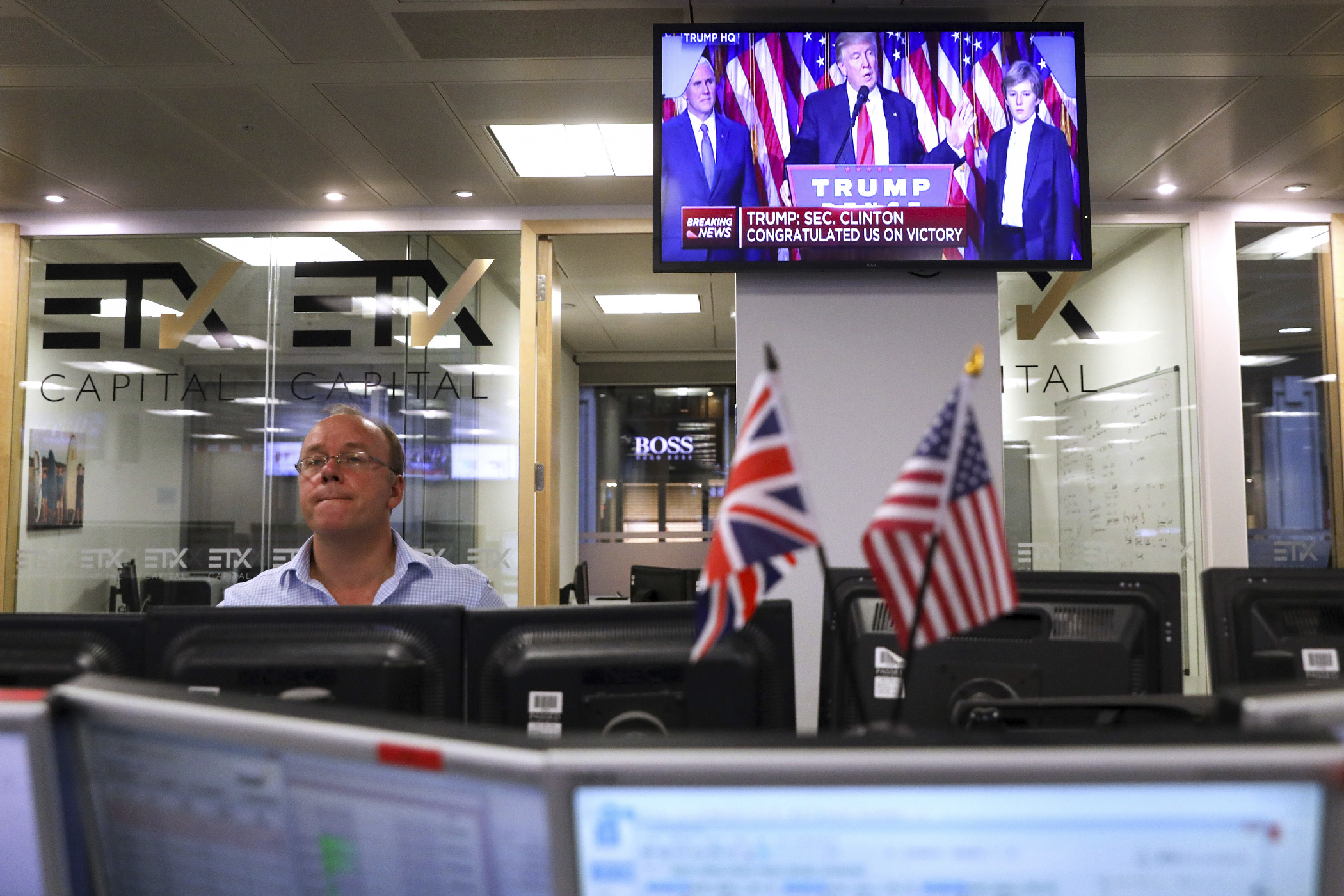 Traders on thefloor at ETX Capital in London watched as Trump was elected. The UK markets suffered huge losses in June, after their own surprise Brexit referendum results sent stocks into a tailspin.