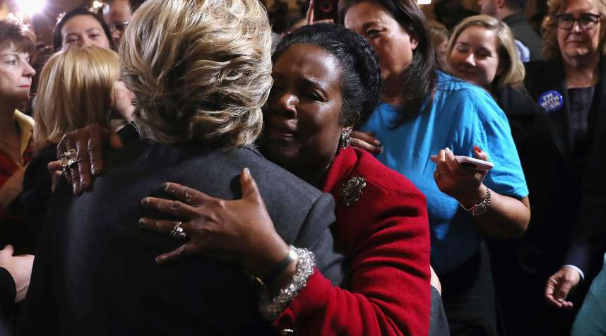 Former Secretary of State Hillary Clinton hugs supporters after conceding the presidential election at the New Yorker Hotel on November 9, 2016 in New York City. Republican candidate Donald Trump won the 2016 presidential election in the early hours of the morning in a widely unforeseen upset.