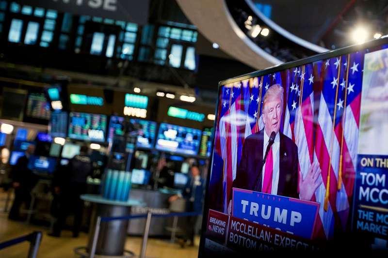 U.S. President-elect Donald Trump is seen speaking on a television on the floor of the New York Stock Exchange (NYSE) in New York, on Wednesday, Nov. 9, 2016. U.S. stocks fluctuated in volatile trading in the aftermath of Trump's surprise presidential election win, as speculation the Republican will pursue business-friendly policies offset some of the broader uncertainty surrounding his ascent.