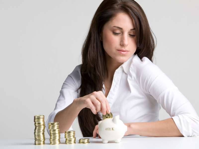 Woman investing money into her 401k piggy bank