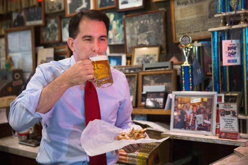 A rare instance of Wisconsin Gov. Scott Walker eating something other than a ham-and-cheese sandwich, while campaigning in 2015.