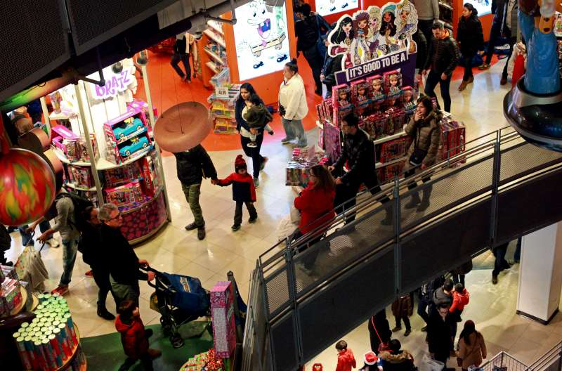 Customers shop in Toys R Us in Times Square on Thanksgiving evening for early Black Friday sales on November 26, 2015 in New York City.