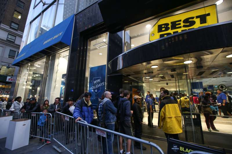 Shoppers are seen outside a shop on the first day of Black Friday in New York on November 27, 2015.