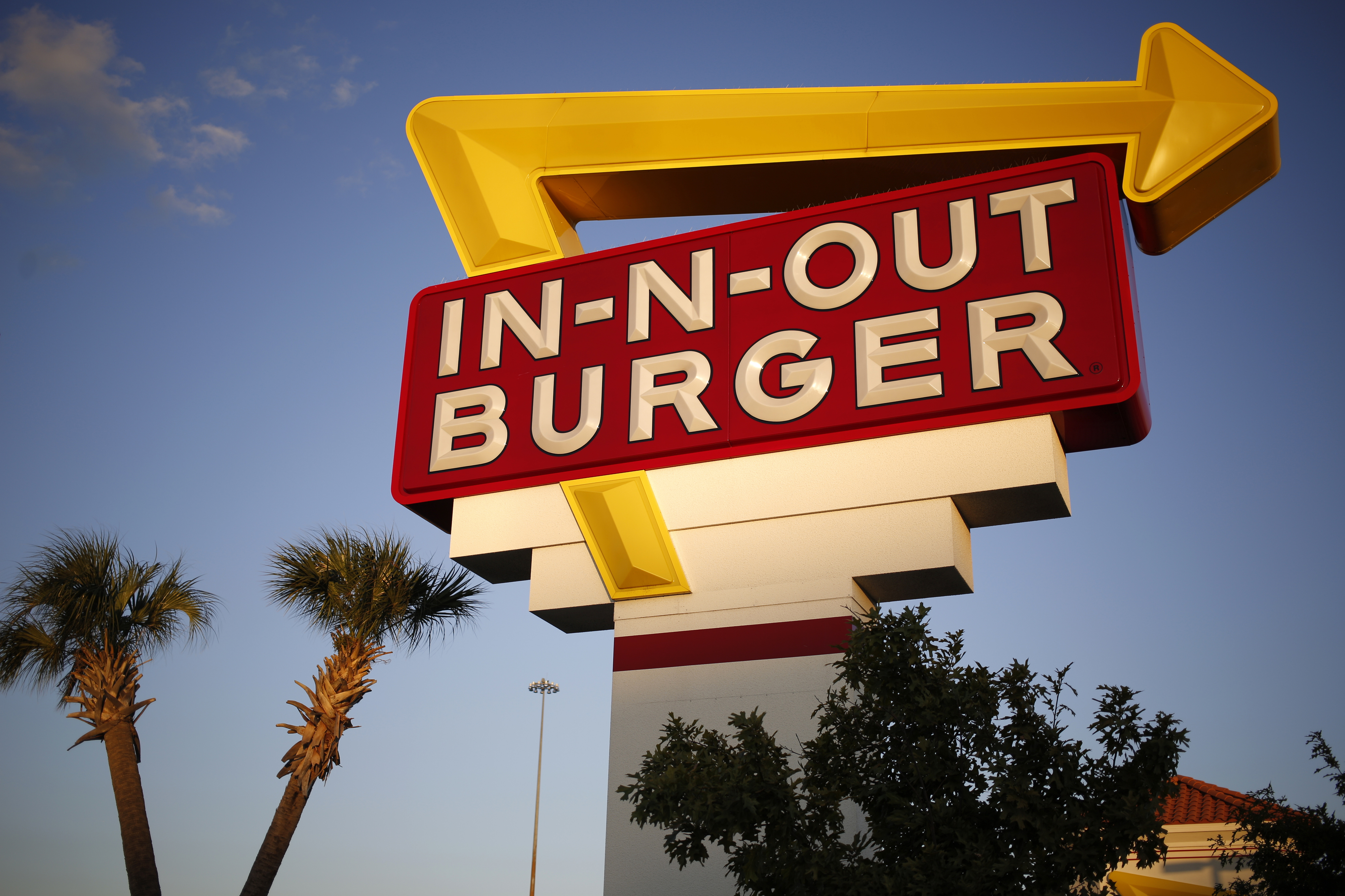 Signage is displayed outside an In-N-Out Burger restaurant in Fort Worth, Texas, U.S., on Monday, Oct. 24, 2016.