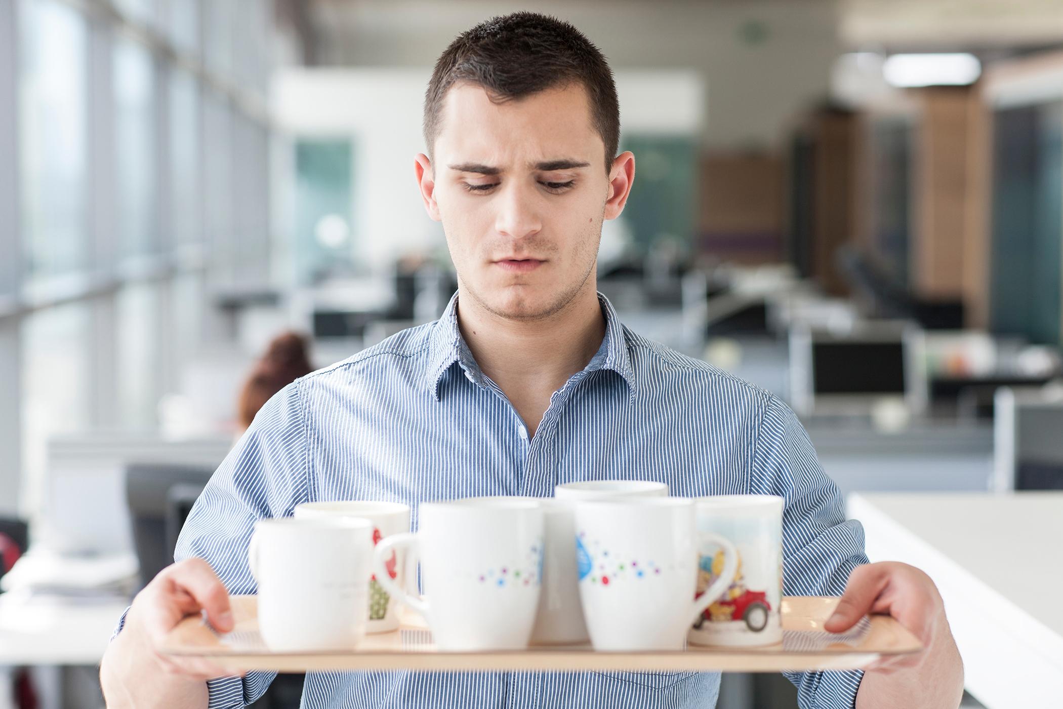 Intern carrying coffee