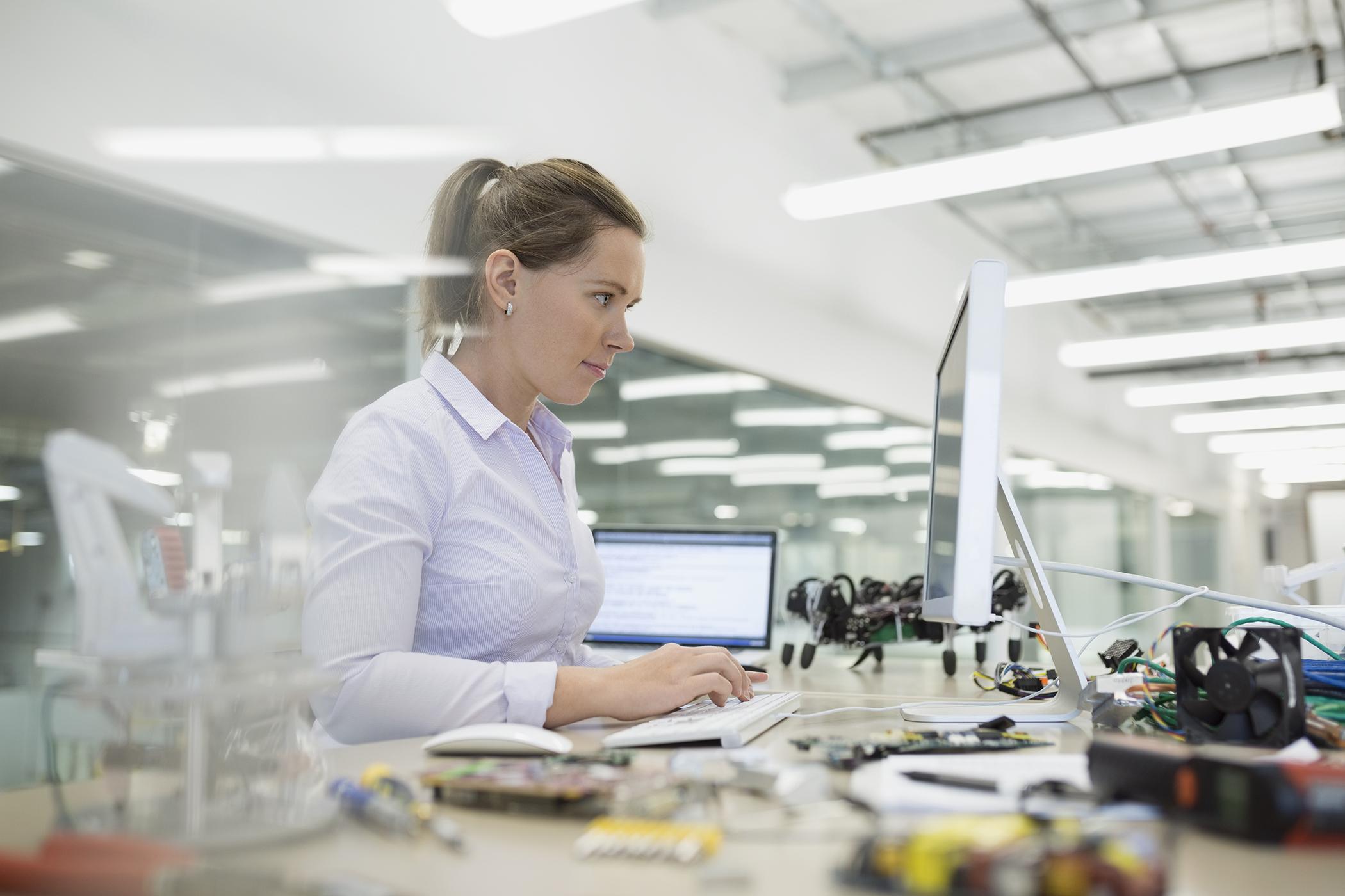 Worker at tech desk