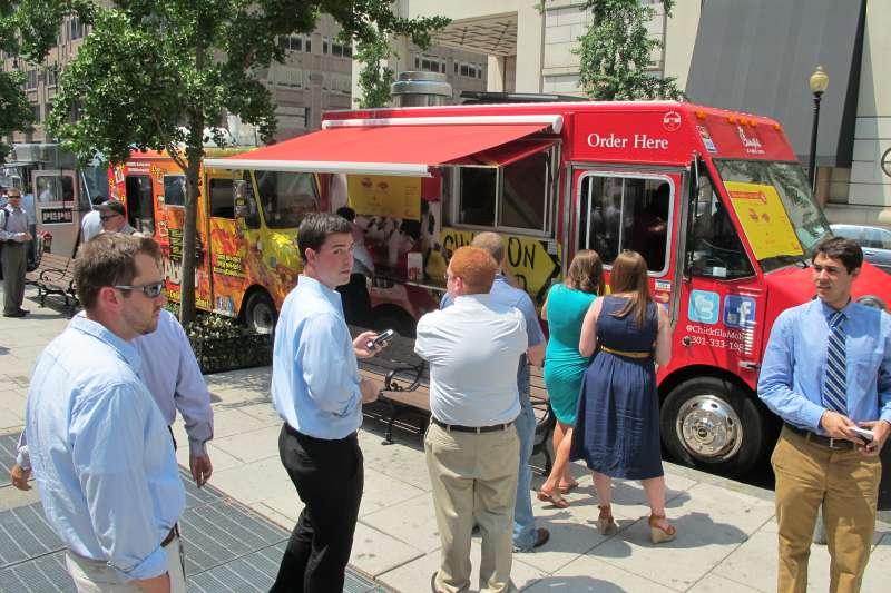 Customers line up at a Chick-fil-A food truck in Washington on 26 July, 2012.