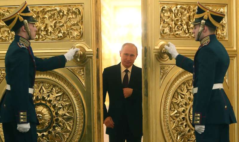 Russian President Vladimir Putin enters the St. George Hall of the Grand Kremlin Palace in Moscow, on December 12, 2013, to deliver an annual state of the nation address.