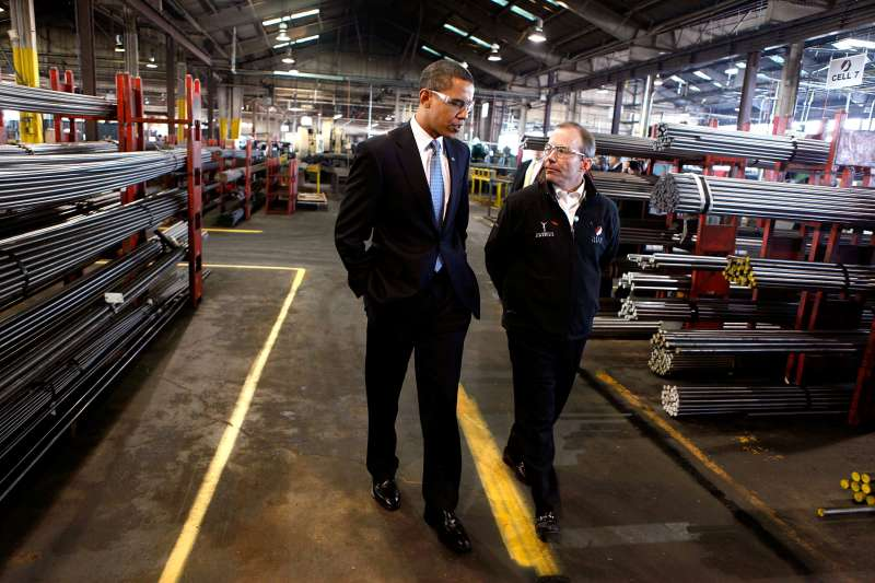 Barack Obama tours Cardinal Fasteners Specialty Company with the company president John Grabner January 16, 2009 in Bedford Heights, Ohio.