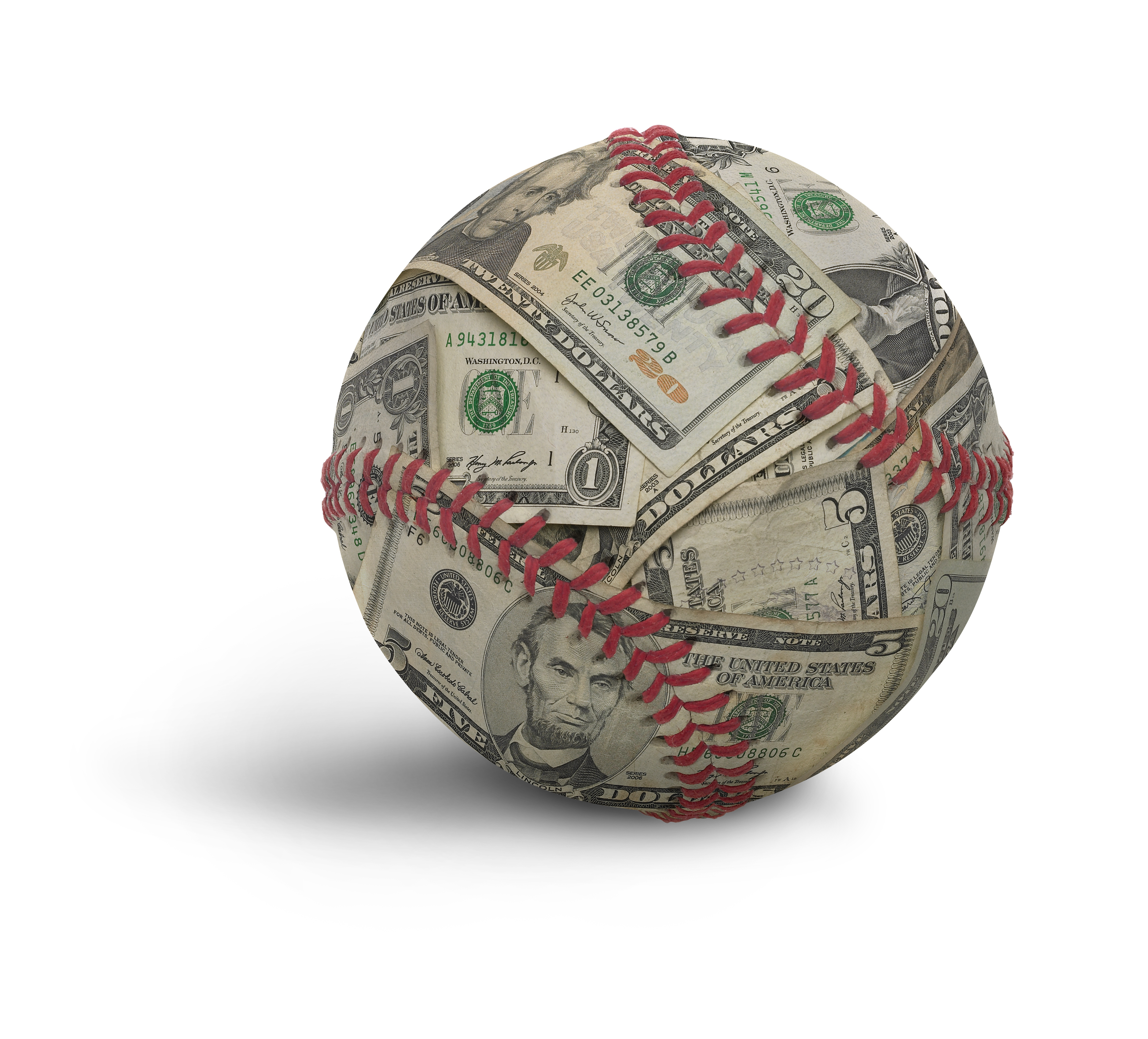 A baseball made out of money. Laces are still showing through. Intended to show the commercialization of sports. The image has an embedded clipping path.