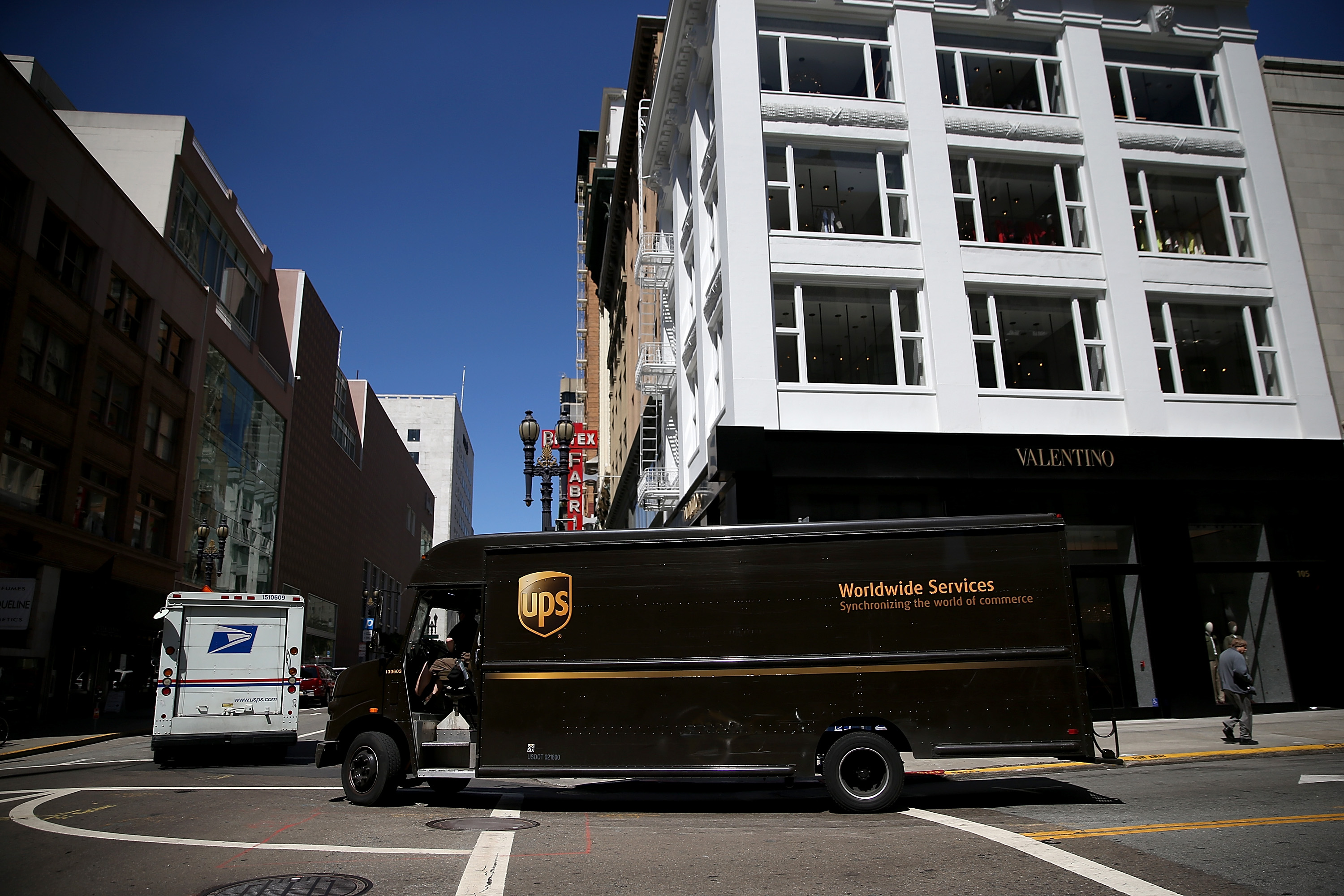 SAN FRANCISCO, CA - JUNE 17:  A United Parcel Service (UPS) drives through an intersection on June 17, 2014 in San Francisco, California.
