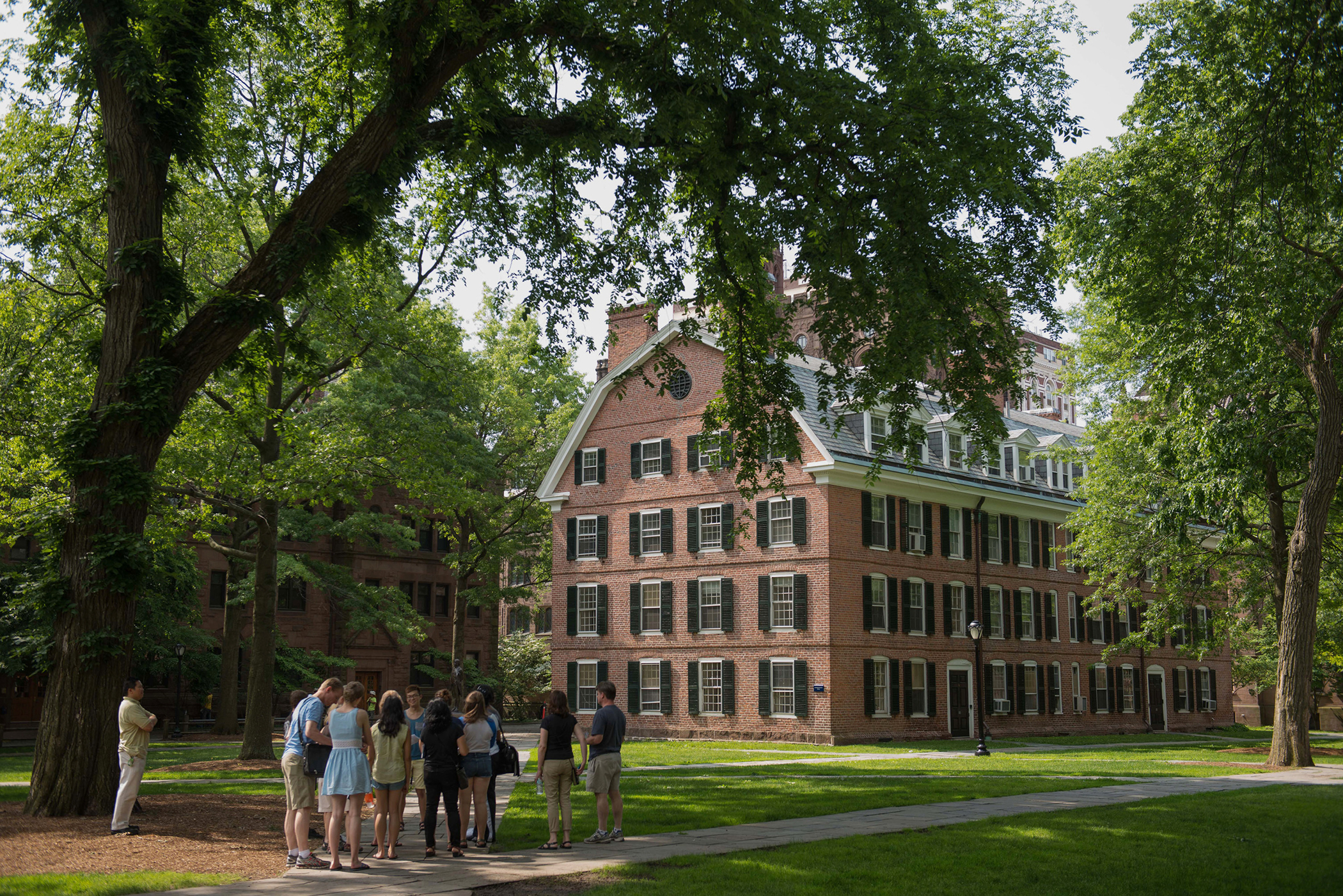 A tour group makes a stop at Connecticut Hall on the Yale University campus in New Haven, Connecticut, U.S., on Friday, June 12, 2015. Yale University is an educational institute that offers undergraduate degree programs in art, law, engineering, medicine, and nursing as well as graduate level programs.