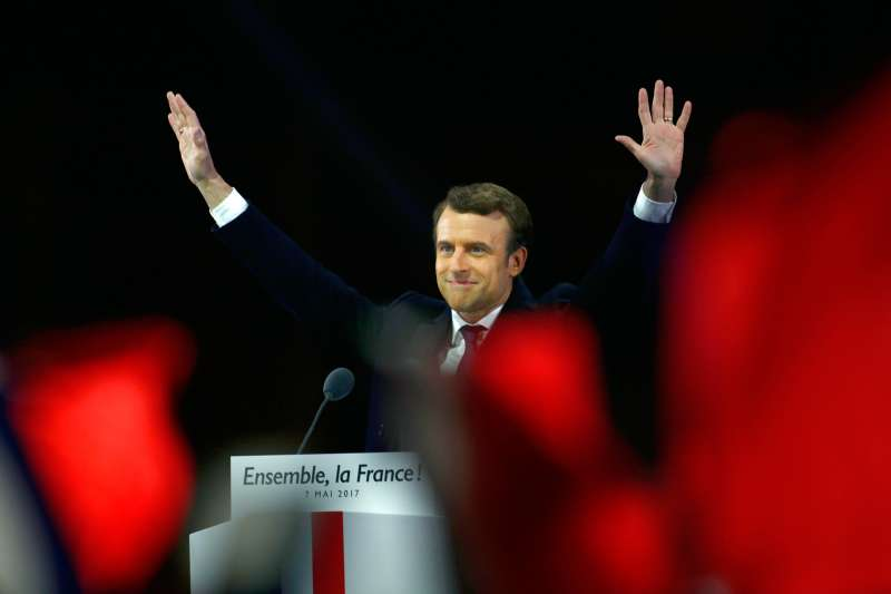 Emmanuel Macron salutes voters and celebrates his presidential election victory in Paris, on May 7, 2017.