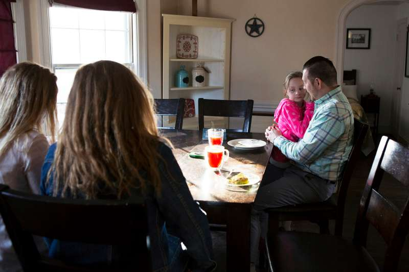 Nathan Bonds spends time at home with his daughters Courtney (15), Sierra (16), and Ava (7) before leaving for work.