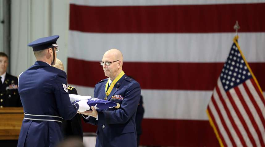 Brig. Gen. Brent Feick, outgoing director of joint staff for the Alaska National Guard, participates in a flag folding ceremony during his retirement ceremony at Joint Base Elmendorf-Richardson, Alaska, on April 1, 2017.