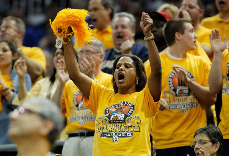 Marquette University fans cheer for their team  in Louisville, Kentucky March 17, 2012.