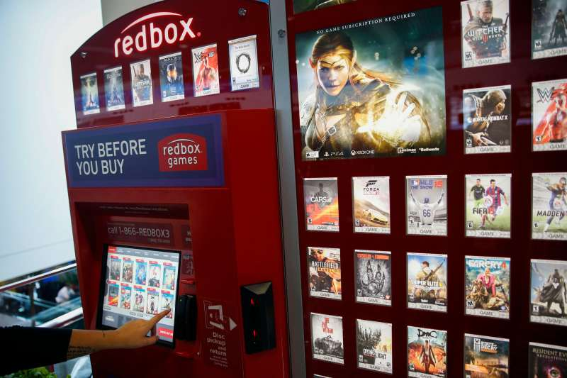 A Redbox video games rental kiosk is demonstrated before the opening the E3 Electronic Entertainment Expo in Los Angeles, California, U.S., on Tuesday, June 16, 2015.