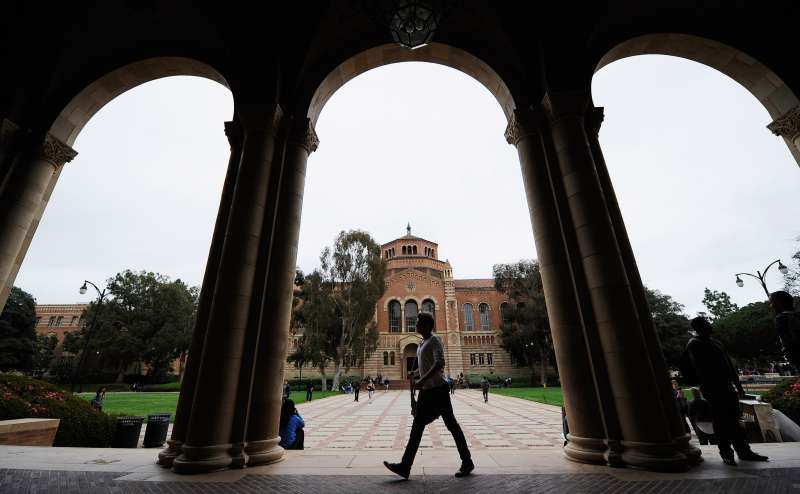 A student walks near Royce Hall on the campus of UCLA in Los Angeles, California.