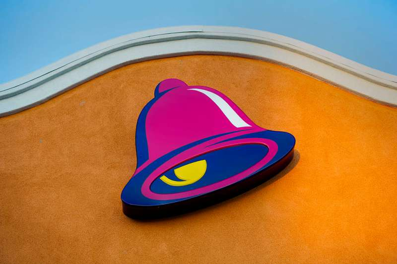 The logo for Taco Bell, a unit of Yum! Brands Inc., is displayed outside of a restaurant in Daly City, California, U.S., on Friday, April 18, 2014.