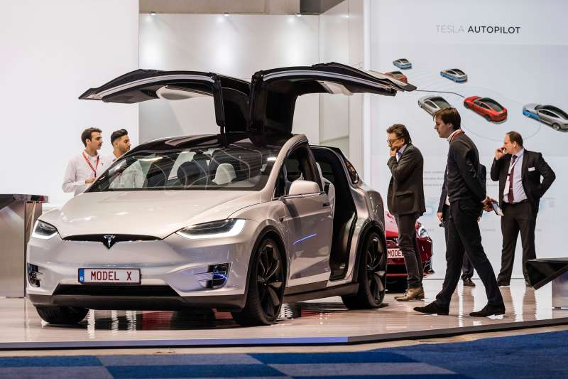 Men look at the Tesla Model X during the media day of the 95th European Motor Show in Brussels on Jan. 13, 2017.