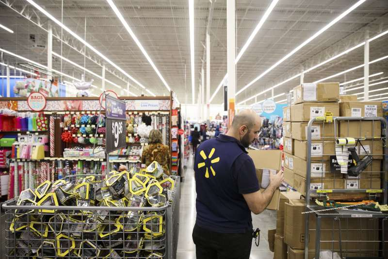 An employee unboxes toys for sale at a Wal-Mart Stores Inc. location in Burbank, California, U.S., on Tuesday, Nov. 22, 2016.