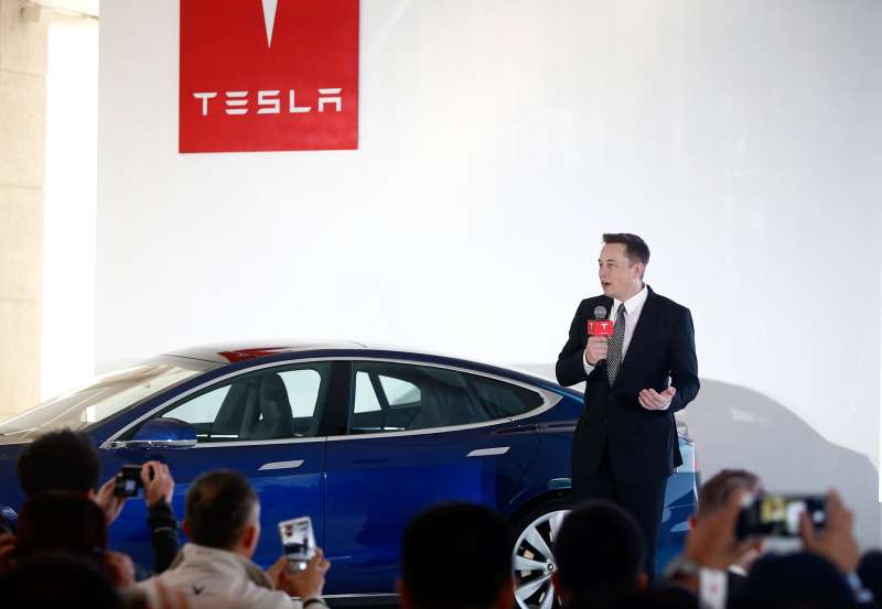 Elon Musk, Chairman, CEO and Product Architect of Tesla Motors, addresses a press conference to declare that the Tesla Motors releases v7.0 System in China on a limited basis for its Model S, on October 23, 2015 in Beijing, China.