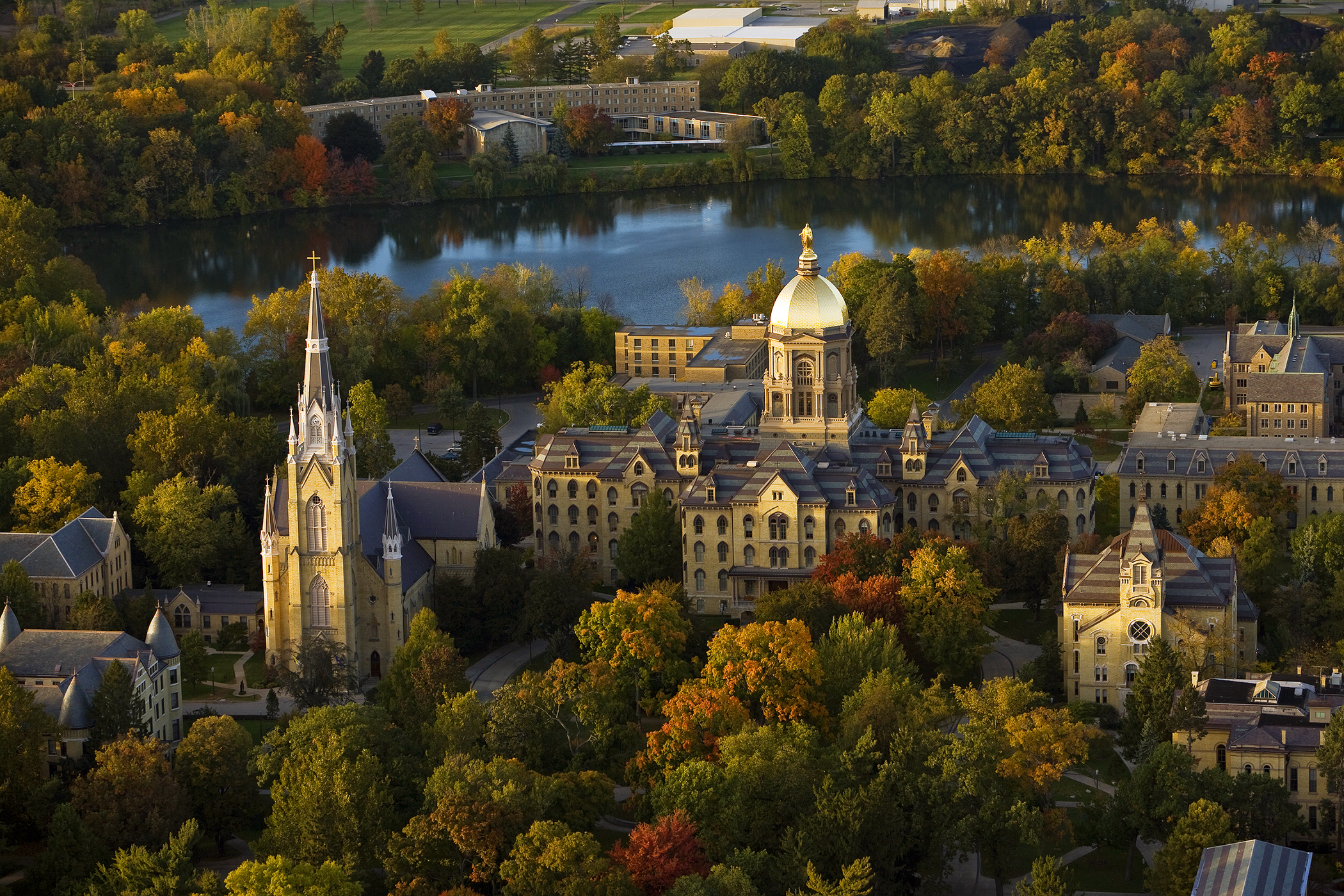 """University of Notre Dame (No. 40) main building and Basilica, also known as """"God Quad,"""" in fall.170710-C0L-notre-dame"""