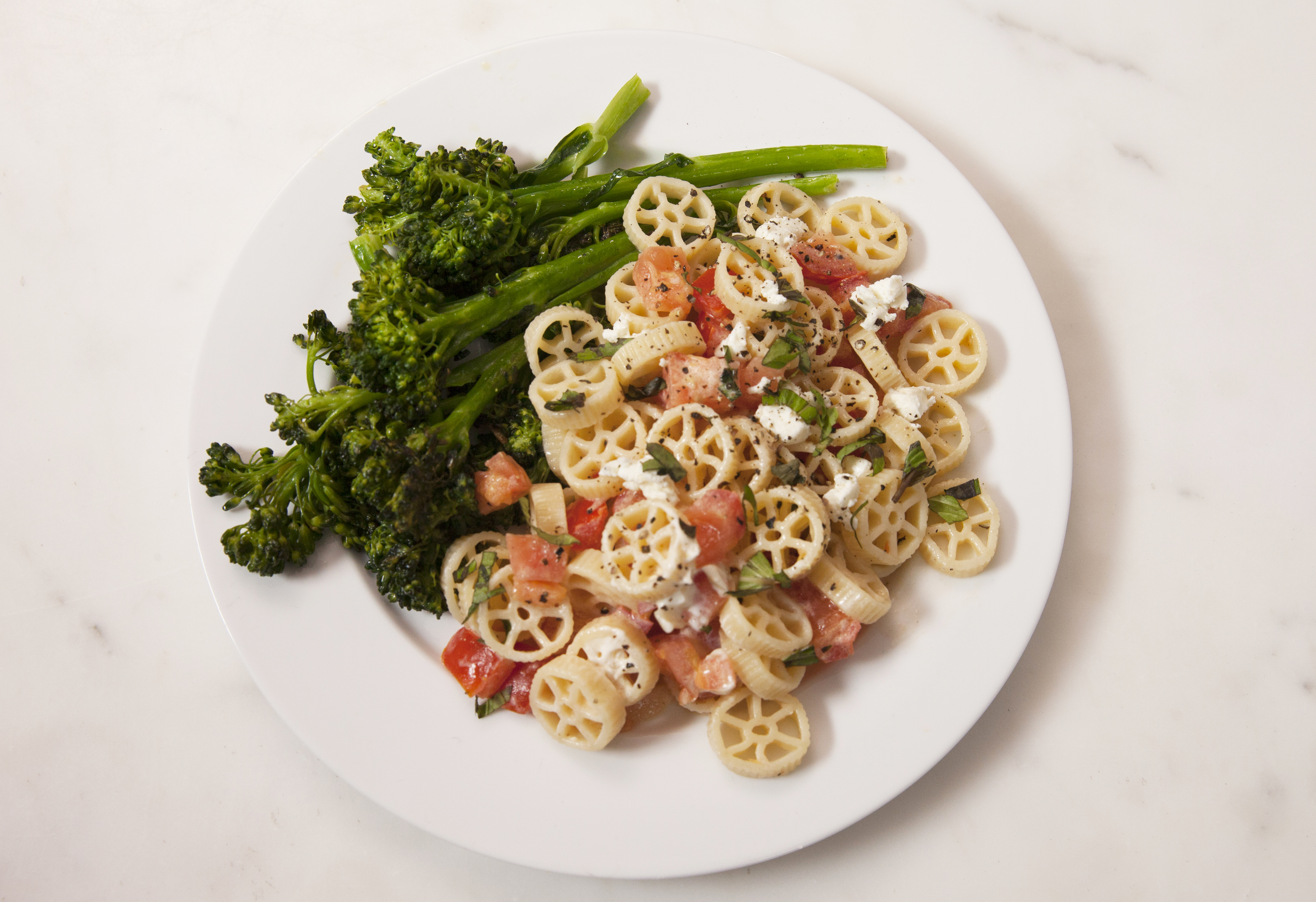 Marley Spoon's Creamy Wagon Wheel Pasta with tomatoes and garlicky broccolini.