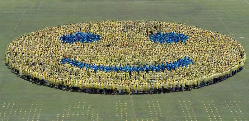 Students in Nanjing, China, stand in formation on a field as they form a smiley face in an attempt to break a world record.