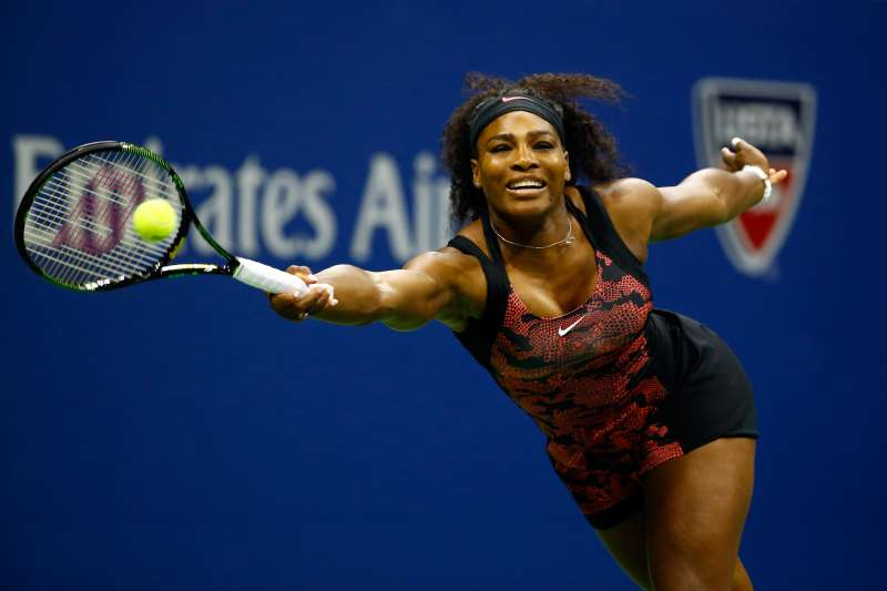 Serena Williams of the United States returns a shot against Venus Williams of the United States during their Women's Singles Quarterfinals match on Day Nine of the 2015 US Open at the USTA Billie Jean King National Tennis Center on September 8, 2015 in the Flushing neighborhood of the Queens borough of New York City.
