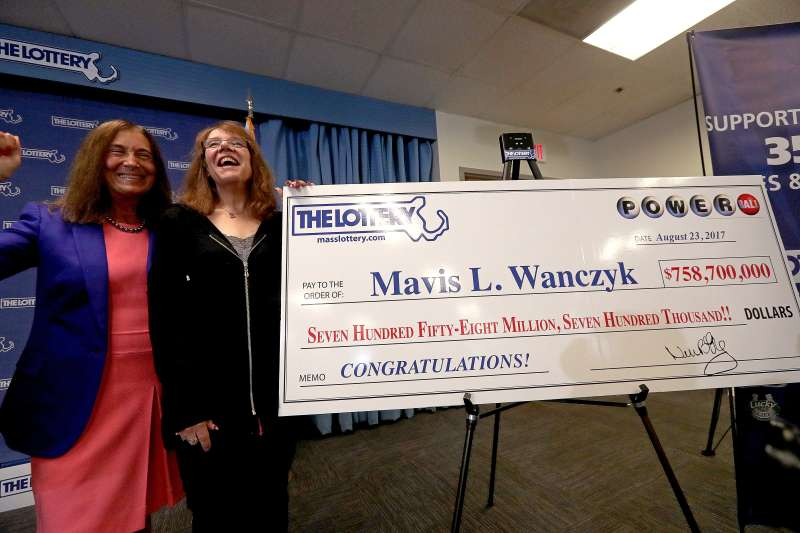 Winner of the $758.7 million Powerball jackpot Mavis L. Wanczyk, right, poses for a photo with Massachusetts State Treasurer Deborah Goldberg, left, in Braintree, Mass., Aug. 24, 2017.