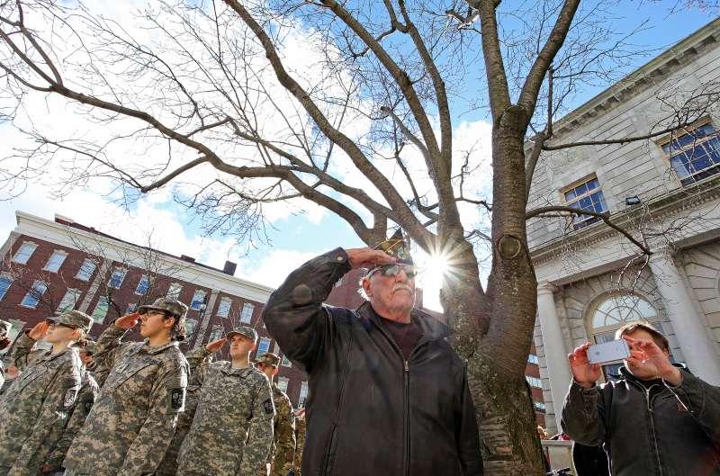 Paul Avery, commander of Harold T. Andrews American Legion Post 17, salutes during Veteran's Day ceremonies in Portland, Maine.