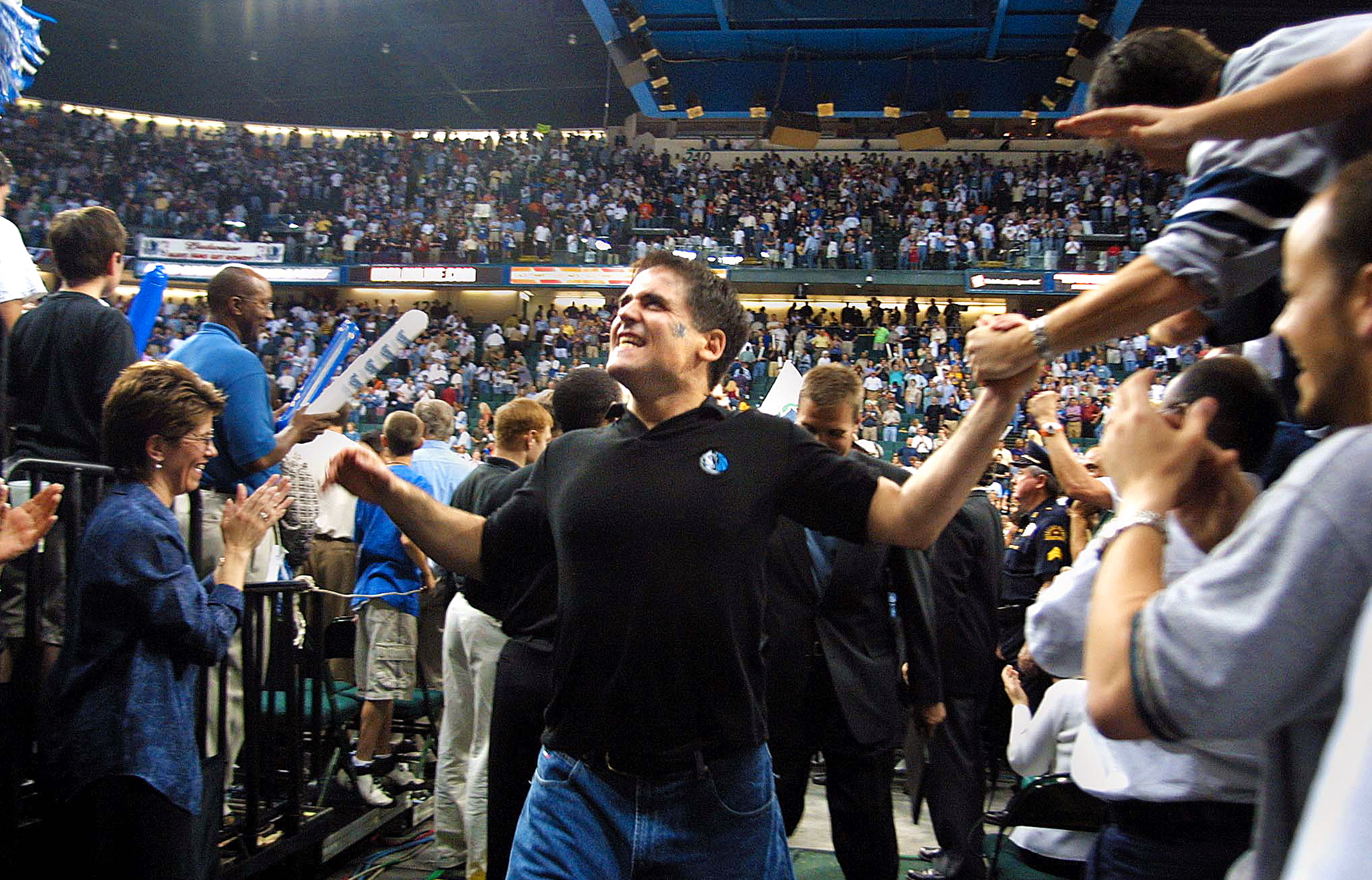 Cuban celebrates with Dallas fans in 2001 following a Mavericks home win over the Utah Jazz.