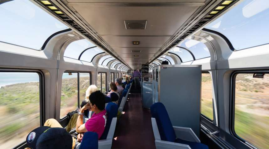 Observation carriage of a long distance train travelling along the scenic Californian coastline. USA