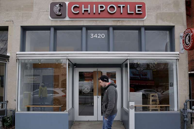 A man walks by a Chipotle Mexican Grill in Washington, February 8, 2016.