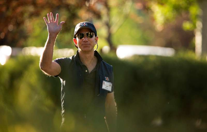 Jeff Bezos, chief executive officer of Amazon.com Inc., arrives for a morning session during the Allen & Co. Media and Technology Conference in Sun Valley, Idaho, on July 11, 2014.