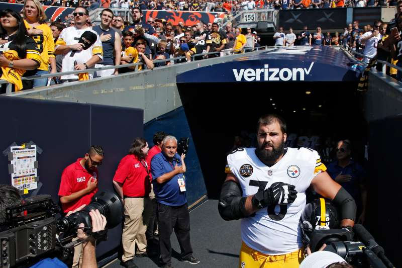 Alejandro Villanueva #78 of the Pittsburgh Steelers stands by himself in the team's tunnel during the national anthem prior to a game against the Chicago Bears at Soldier Field on September 24, 2017 in Chicago, Illinois.