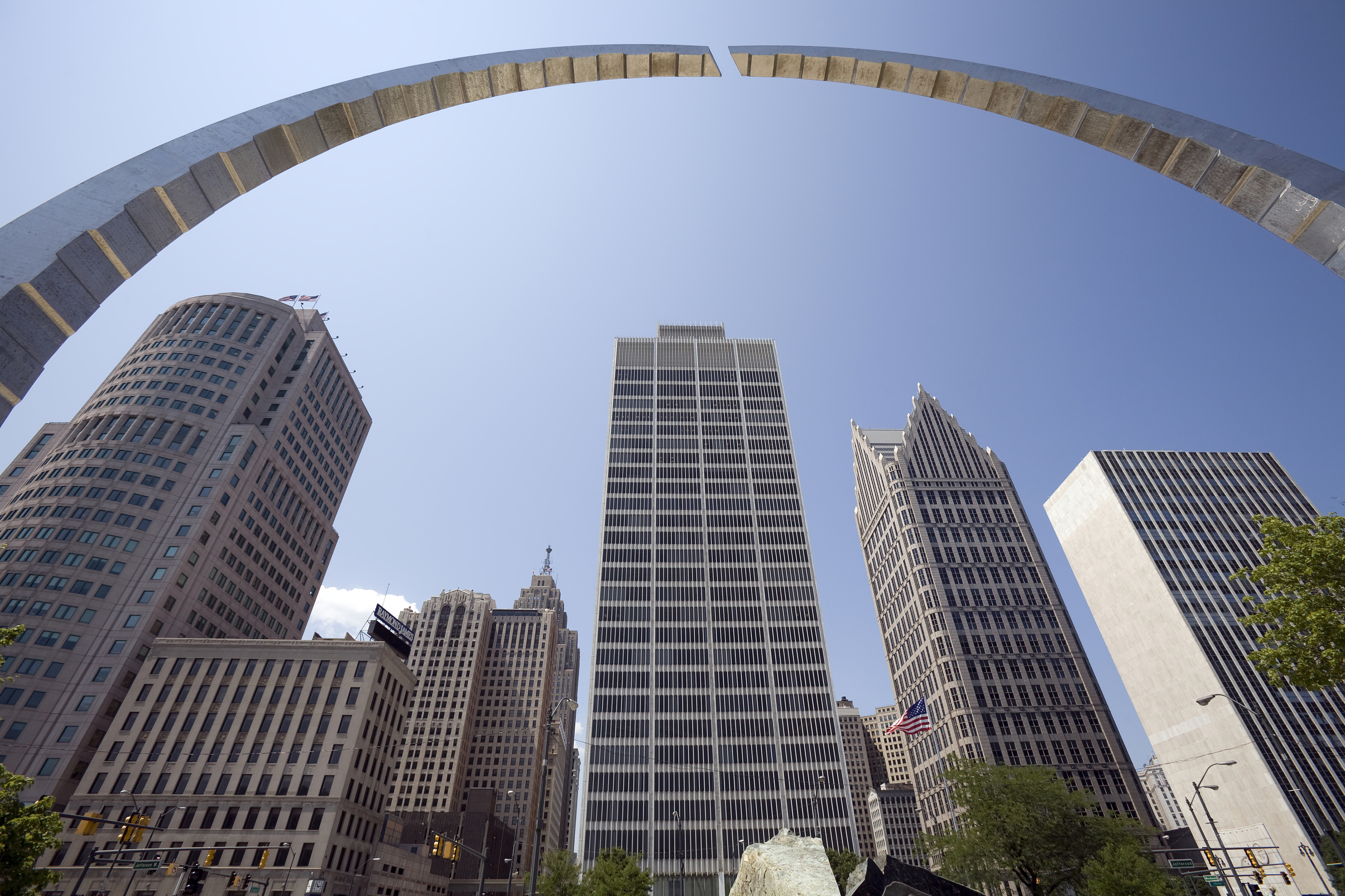 An Arch Sculpture And Skyscrapers In Downtown Detroit